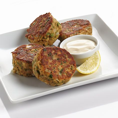 Salmon Patties. Delicious patties filled with salmon, minced onions, sour cream and a splash of lemon juice. Served golden brown.