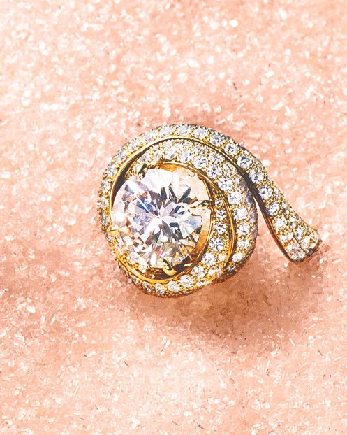 """Cartier """"Trinity Ruban"""" solitaire diamond with side diamonds, cartier.us."""