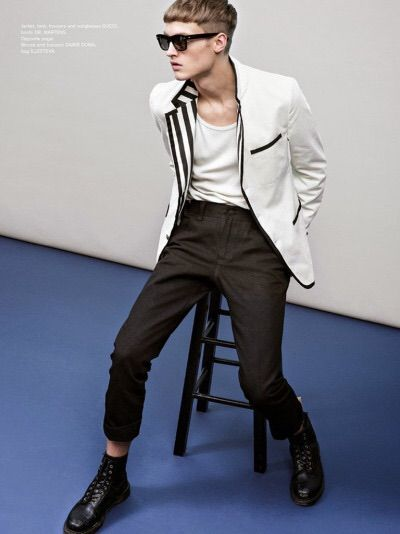 Modern B/W look: dropped-crotch/cropped trousers, tank, white blazer with contrast lapel, and boots (edgy guy).