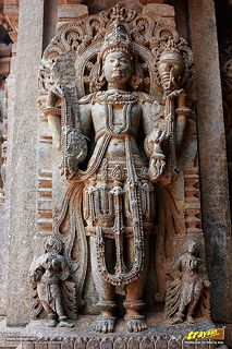 Relief sculpture of a Hindu god on the outer walls of Keshava Temple…