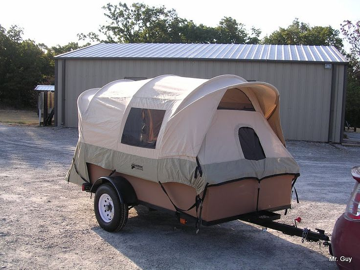 DIY tent trailer -this is a truck bed tent on a trailer. If you click through to the link he explains how he did it so that all he has to do is lay the bows down flat without having to disassemble the tent