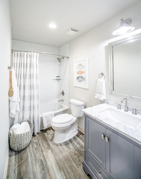 This kid's bathroom remodel features Atlantic City Tile Floors and Benjamin Moore Classic Gray walls designed by Jesse Bodine, co-founder of Scout & Nimble.