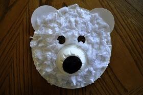 Polar Bear Faces!  Paper plate, fruit cup, tissue paper, black & white construction paper.  Easy!