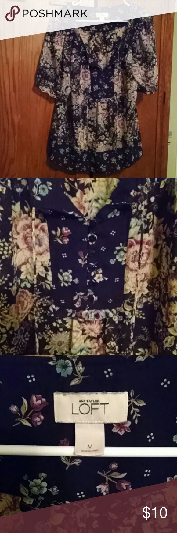 Anne Taylor Loft floral blouse This top is a sheer floral  fabric. It is navy blue with lighter blue and purple flowers. There is a 6 button and tie detail on the front. In very good used condition. LOFT Tops Blouses