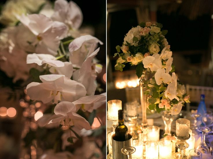 More flowers!! The white orchids fall elegantly on the table and the compositions have lots of roses to complete the elegant setting.