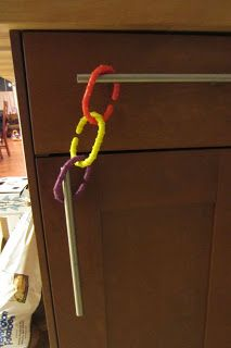 Toddler-proofing cabinets with what you have on hand. Brown Thumb Mama: How Does She DO It?