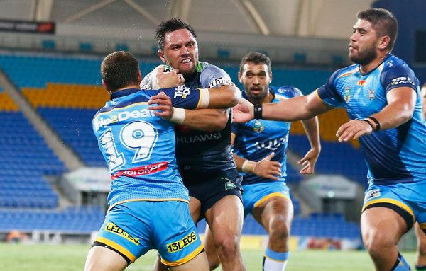 Jordan Rapana of the Raiders breaks the Titans defence to score a try during the round six NRL match between the Gold Coast Titans and the Canberra Raiders at Cbus Super Stadium on April 8, 2017 in Gold Coast, Australia.