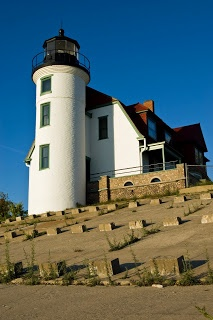 Point Betsie Lighthouse - Lake Michigan - Built in 1858 at 52 ft above lake level. In 1875 the life saving station was built. The light was originally equipped with a 4th Order Fresnel lens with a bulls eye & upgraded to a 3rd Order in 1880. The cylindrical tower is 39 ft tall on a dune. It's attached to the keeper's house & upgraded to an attractive gambrel roof design. It was manned for 106 yrs & the last lighthouse on Lake Michigan to lose its keeper when it was automated in 1983.