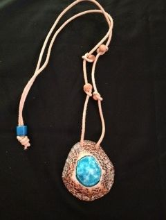 Limpet shell with porcelaine glaze and adjustable leather thong medallion with wooden bead detail.
