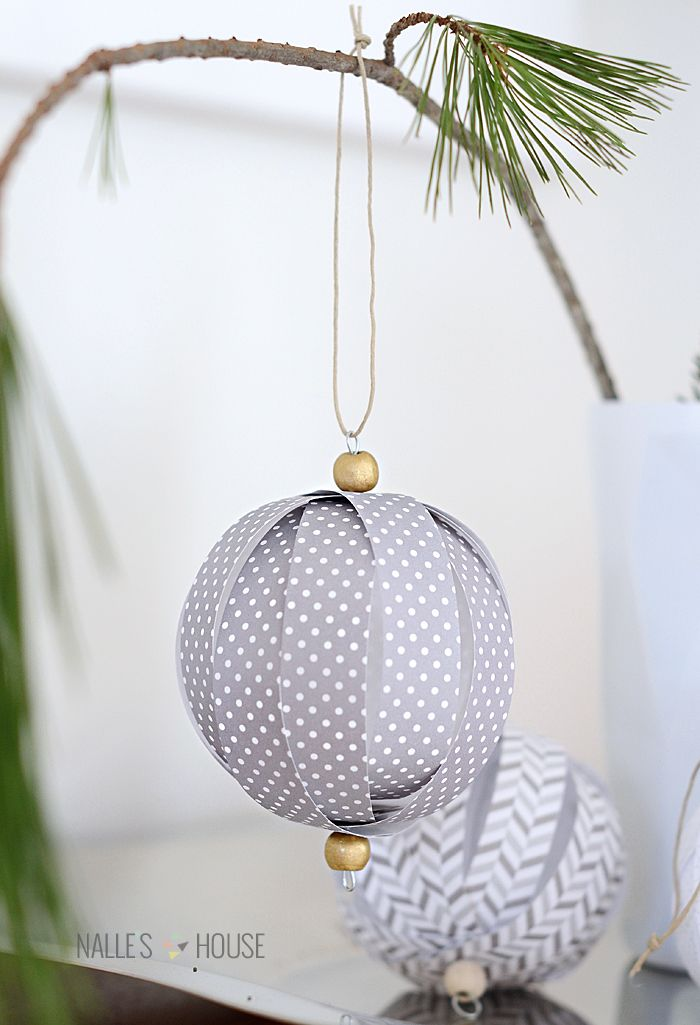 paper ball ornaments made from paper strips held together with string and beads
