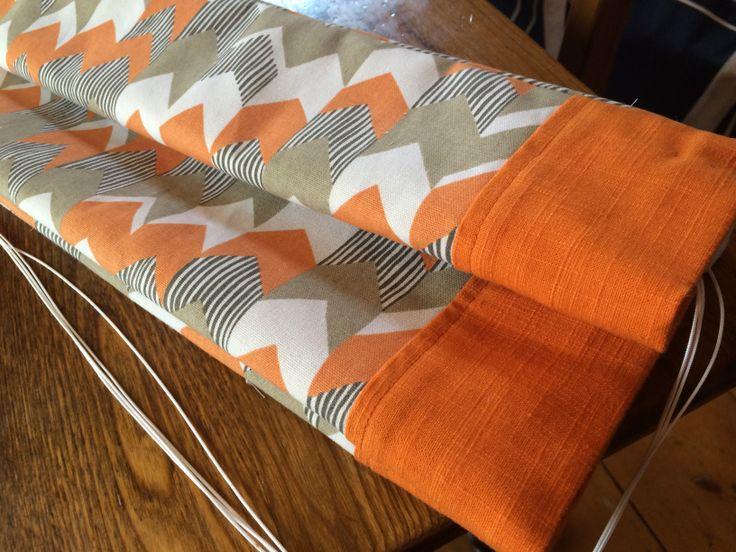 orange geometric with band