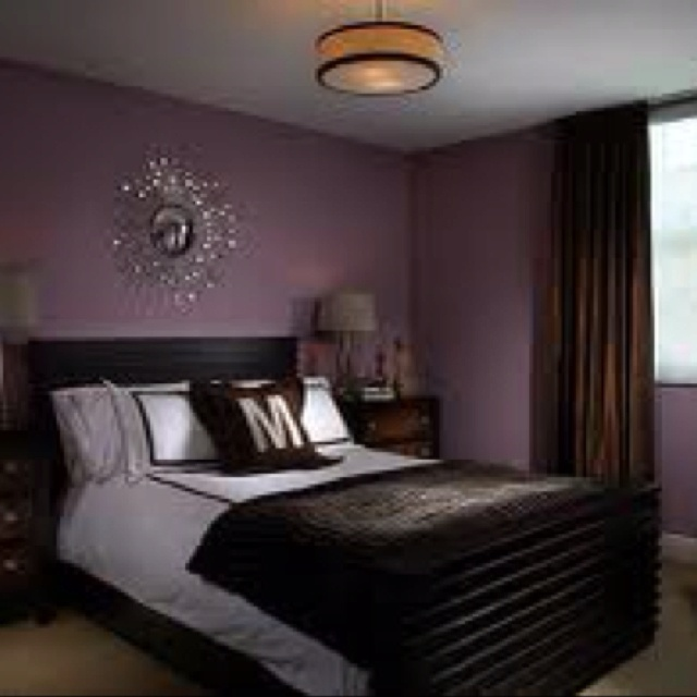 Deep purple bedroom wall color with silver chrome accents for Black wall room ideas