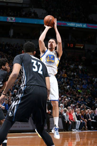 Klay Thompson of the Golden State Warriors shoots the ball during the game against the Minnesota Timberwolves on March 10 2017 at Target Center in...