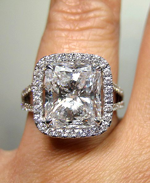7.7 carat diamond oval cut center stone ring with triple halo micropaved diamond ring with detached double (diamond micropaved) bands :)