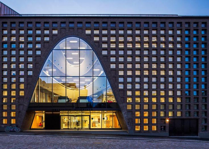 Curving voids pierce the floors of Anttinen Oiva's Helsinki library.