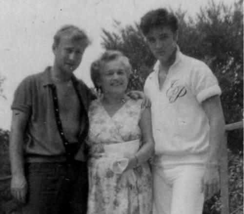"""Memphis, TN, Friday August 9, 1957: Actor Nick Adams (""""Rebel Without a Cause"""") and his mother, Catherine Adamshock (neé Kutz, April 17, 1010 – March 1995), visit Elvis and his parents at Graceland. This close up shows Nick Adams with his mom Catherine Adamshock and Elvis wearing his monogrammed shirt by the pool. See more at: https://allysunshine.wordpress.com/?s=Catherine+Adamshock"""