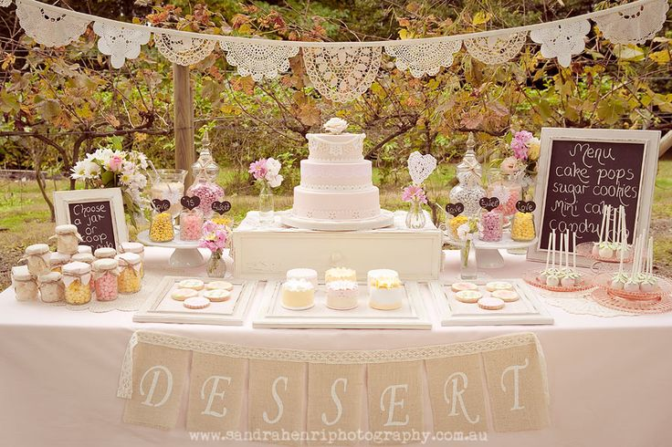 Love this sweet table. It offers a great variety of candy and cookies along with of course cake!  (and the little mason jars to the left are favors!)