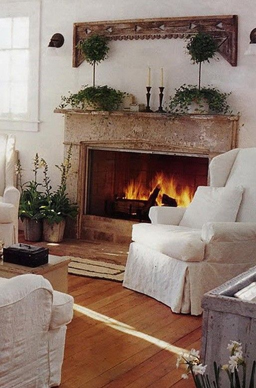 2013 Christmas Fireplace decor, fresh green garland, white candles, Fireplace Decor Ideas for Christmas #Christmas #Fireplace #decor www.loveitsomuch.com
