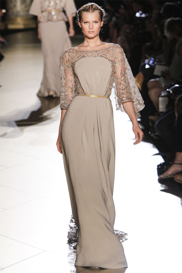 Elie Saab- despite its simplistic color, this dress cannot go unnoticed, the details on the sleeves are incredible