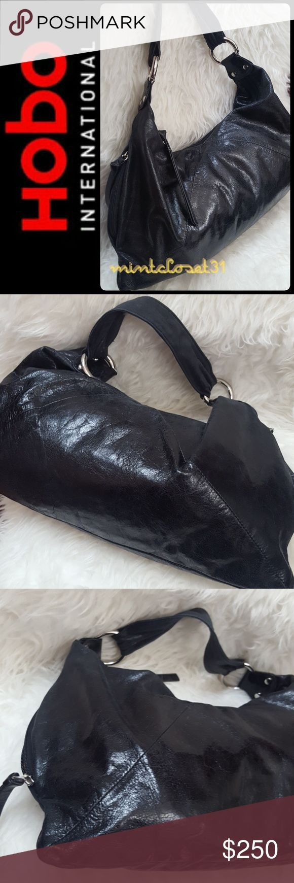 Hobo International Leather Bag New!!! Hobo International Signature Bag in Rare Limited Edition Genuine Leather Hobo! Gorgeously Created with Combined Luxury of Black Leather in Slouchy Silhouette! Silver Tone Hardware with Round Metal on both Ends! Minimalistic style For Everyday Use!  Classy Single Handle Drop About 9 Inches! Top Zipper Closure Opens to Fully Lined Interior with Zipped and Slip Pockets! Very Soft and Luxurious! NEW WITHOUT TAG!! 9x17 inches HOBO Bags Hobos