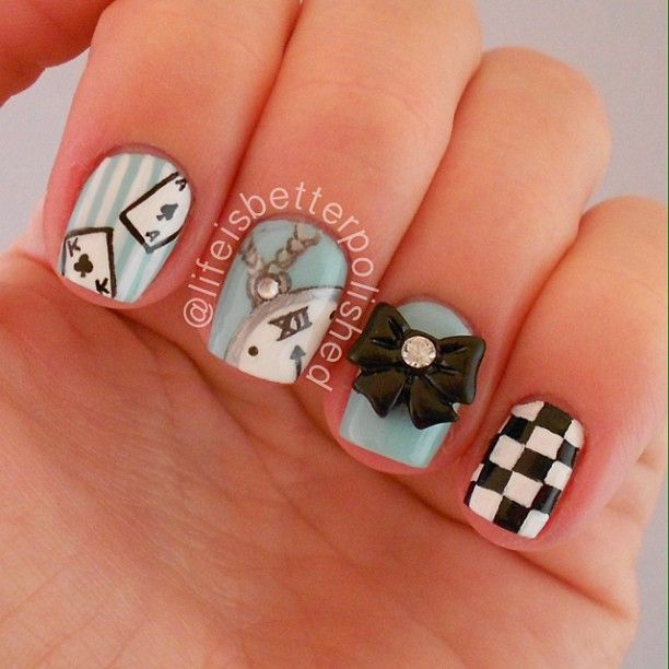 Lewis Carroll's Alice in Wonderland inspired nail art featuring the playing cards, Mr Rabbit's pocket watch and bow tie and a checkerboard print - Instagram photo by lifeisbetterpolished #nailart...x