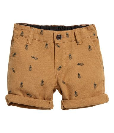 Camel/pineapple. Shorts in soft, washed cotton twill with an adjustable elasticized waistband, zip fly with button, side pockets, and mock welt back pocket.
