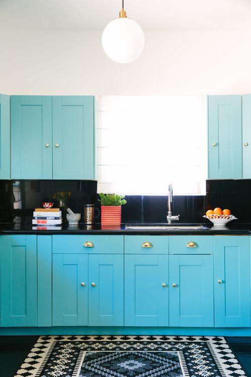 White Kitchen Cabinets With Colorful Blacksplash