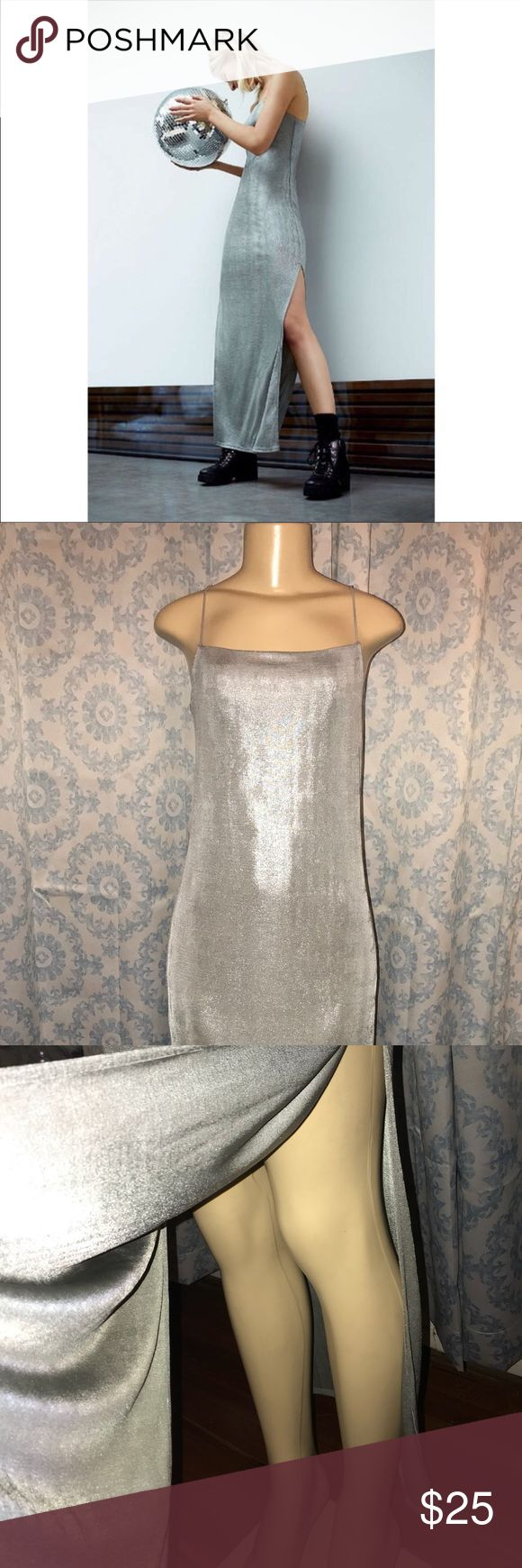 Urban outfitters metallic silver maxi dress Metallic silver maxi dress with thigh high slit. This is a silence and noise/ urban outfitters brand dress. With thin straps. Stretchy material. Perfect for a party! Size large. New never been worn. But no tags!! Urban Outfitters Dresses Maxi