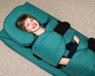 Big Hug Deep Pressure Positioning Aid - used to provide deep pressure for children with sensory integration problems, neurological problems or autism spectrum disorders. This device comes in several sizes and costs between $700-800.