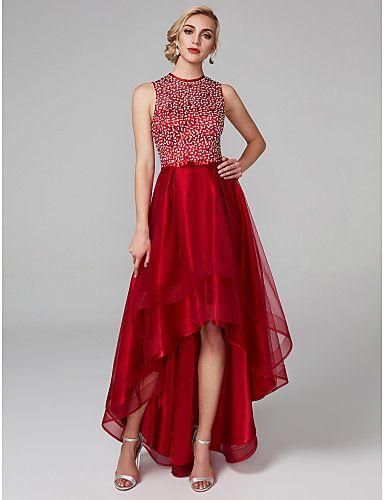 1a0b90b2435c This A-line prom dress gives the look of a full gown with the comfort of a cocktail  dress! The bodice is covered in sparkly sequins and the high-low ...