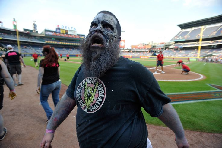 Atlanta Braves fans participate in the team's annual Zombie Walk promotion prior to the first inning of a baseball game against the Oakland Athletics on August 15, 2014, in Atlanta<span>, Georgia</span>.