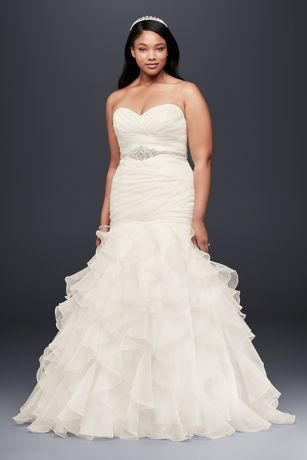 Precise pleats and romantic ruffles offer a contrast of texture and technique on this curve-hugging plus size organza mermaid gown. The lace-up back ensures a perfect fit.   David's Bridal Collection  Plus size  Polyester  Sweep train  Lace-up back; fully lined  Dry clean  Imported  Also available in regular,petite, extra length and plus size extra length