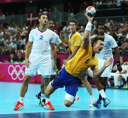Jonas Kallman #6 of Sweden shoots and scores past Jerome Fernandez #2 of France during the Men's Handball Gold Medal Match on Day 16.