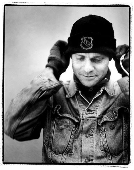 Gord Downie wearing his Tragically Hip toque. The story of the song 'Fifty Mission Cap' at the link.
