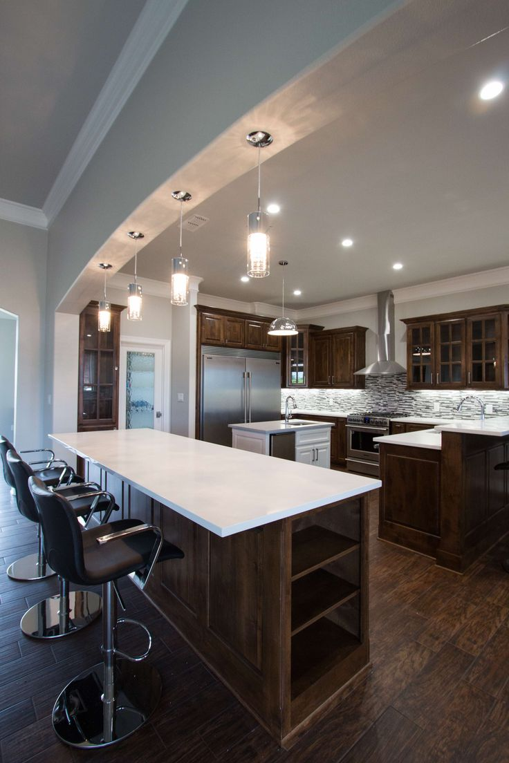 Transitional kitchen with white cliff quartz by Studio B Designs