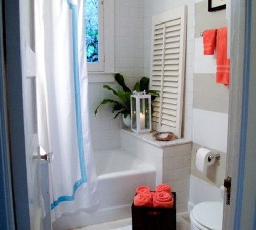striped bathroom with blue and coral accents home sweet