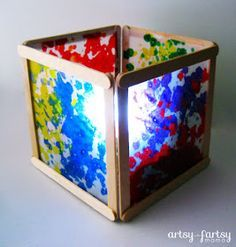 Wax Paper and popsicle stick  lantern for battery-operated tea-light candle -  Instead of melting crayon wax, we will probably glue on squares of tissue paper. However, the students have been collecting broken crayons to recycle and this might be another use for them