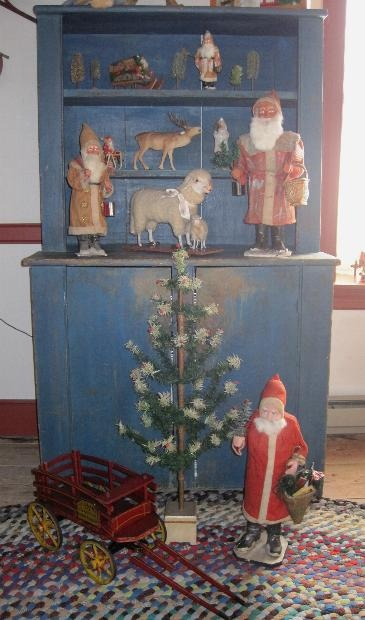 "perfect christmas cupboard; I LOVE the ""Old World"" Santas."