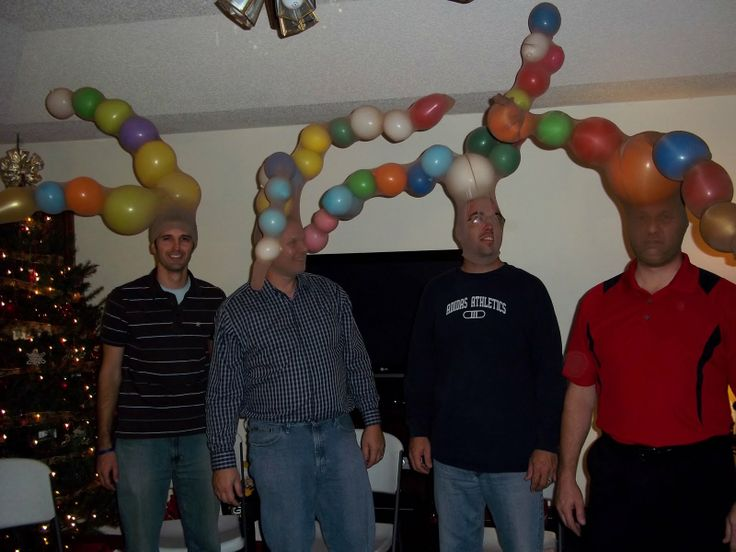 """CHRISTMAS MINUTE TO WIN IT Reindeer Antler Game  Make 2-4 teams.  Hand each team one pair of pantyhose and 1 balloon to each player. Each team should have about 8 balloons.  On the word """"go"""", the teams race to make reindeer antlers, by blowing up the balloons and stuffing them into the pantyhose. Then one team member wears the antlers and sings the first verse of Jingle Bells. The first one to do so wins for the team."""