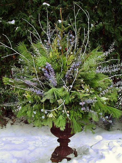 Winter pot with blue eucalyptus and white sticks by Chalet's Specialty Garden Care staff