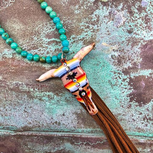 NEW Arrival Serape Longhorn necklace with leather tassel. Only $17.99! Matching earrings also available. Link in the bio.