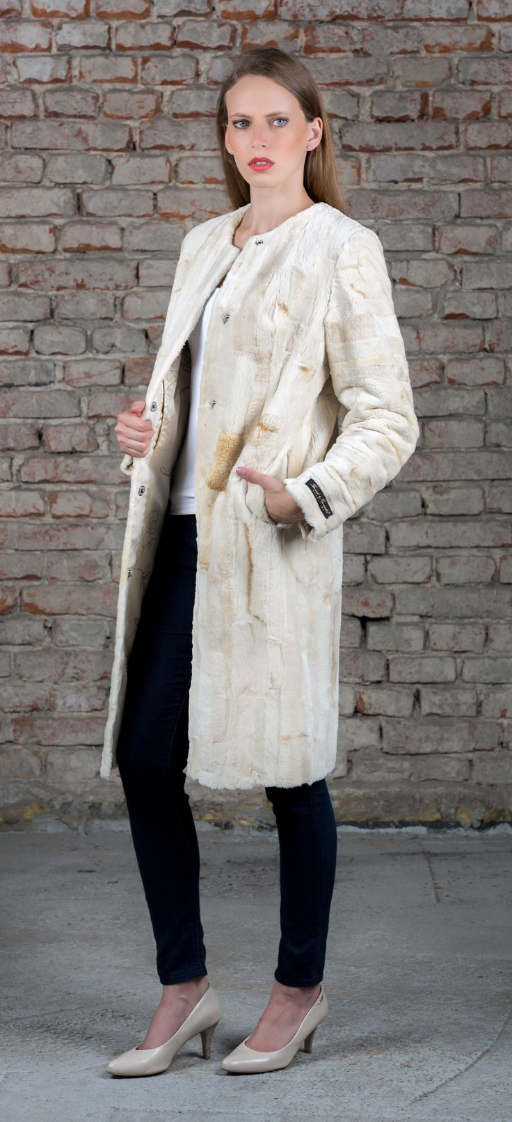SC coat combines two artisan fur processing methods. It is shearing into a velvet style and patchworking.