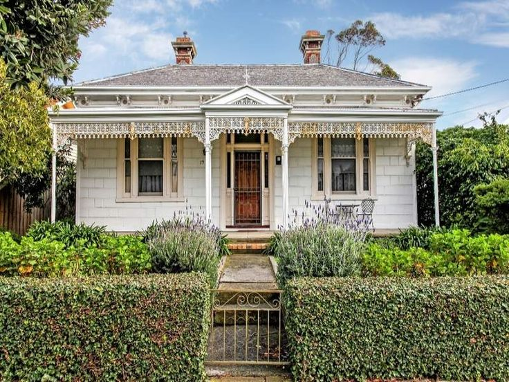 Victorian Cottage - Photo of a weatherboard victorian house exterior with hedged fence & hedging - House Facade photo 526793. Browse hundreds of images of victorian house exteriors & photos of weatherboard in facade designs.