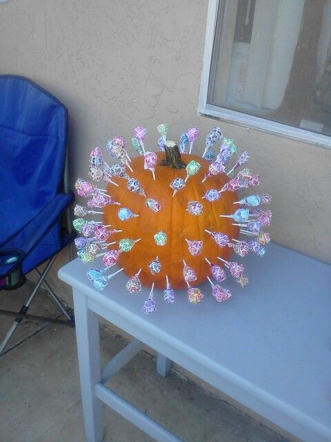 Super fun and easy way to have a fall carnival game. Put in lollipops with blue marker at the bottom of the stick to create a way for the kids to win extra tickets or prizes. :)