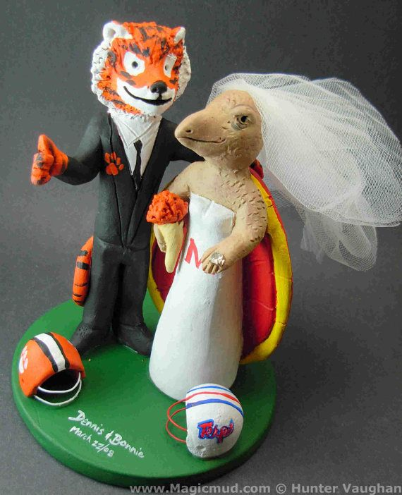 Clemson Tiger Groom Marries Maryland Terrapin Bride, Turtle Bride Wedding Cake Topper, Clemson Graduate's Wedding Cake Topper    This photographed listing is but an example of what we will create for you....simply email or call toll free with your own info and pictures of yourselves, and we will sculpt for you a treasured memory from your wedding!  $235 #magicmud 1 800 231 9814 www.magicmud.com