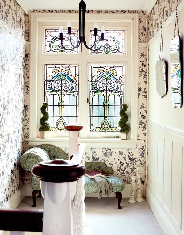stained glass windows - reading nook on the landing. It is the natural light here that changes throughout the day that adds to the charm.