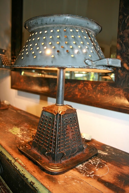 """vintage stove top toaster... vintage colander or something with a """"lampshade"""" like shape and combine the two with the necessary parts to make a lamp...this one take two small 40 watt bulbs that spread horizontally at the top of the fixture...so this is soft diffused light. luv it"""