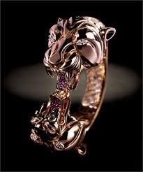 Piovan gioielli - bracciale pantere in oro rosa, diamanti talio navette e rubini