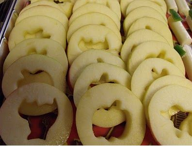 This is such a great idea - slice apples and transform them into a healthy Halloween treat by cutting out spooky shapes - You can serve them with caramel dip!