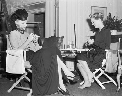 "Bette Davis and Ann Sheridan knitting on the set for ""The Man Who Came to Dinner."""